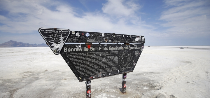 This Monday, Aug. 15, 2016, photo, shows the Bonneville Salt Flats International Speedway sign, near Wendover, Utah. Speed-starved racers are finally back at Utah's world-famous Bonneville Salt Flats to hit speeds of 400 mph or more as they compete in Speed Week for the first time since 2013 after wet weather and rough salt cancelled the races for the last two years. (AP Photo/Rick Bowmer)