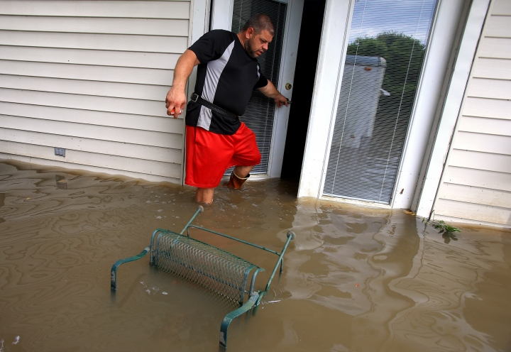 Wade Gary exits his home after viewing the damage in his studio apartment from floodwater Tuesday, Aug. 16, 2016, in Abbeville, La. (Gabe Hernandez/Corpus Christi Caller-Times via AP)