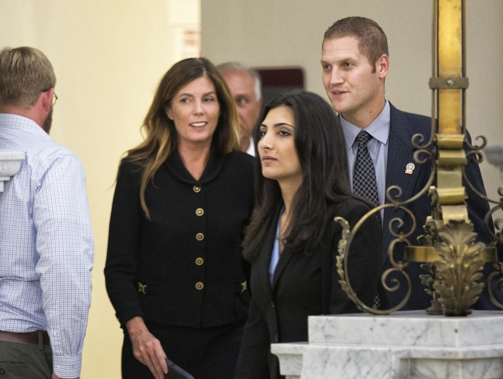 Pennsylvania Attorney General Kathleen Kane, second left, and members of her legal and security teams, prepare to leave the Montgomery County Courthouse and await a verdict, in Norristown, Pa., Monday, Aug. 15, 2016. Kane was convicted Monday of all nine charges against her in a perjury and obstruction case related to a grand jury leak but insisted she's innocent and vowed to appeal. Kane, the first Democrat and first woman elected to the office, showed little emotion as jurors announced their verdict Monday. (Ed Hille/The Philadelphia Inquirer via AP, Pool)