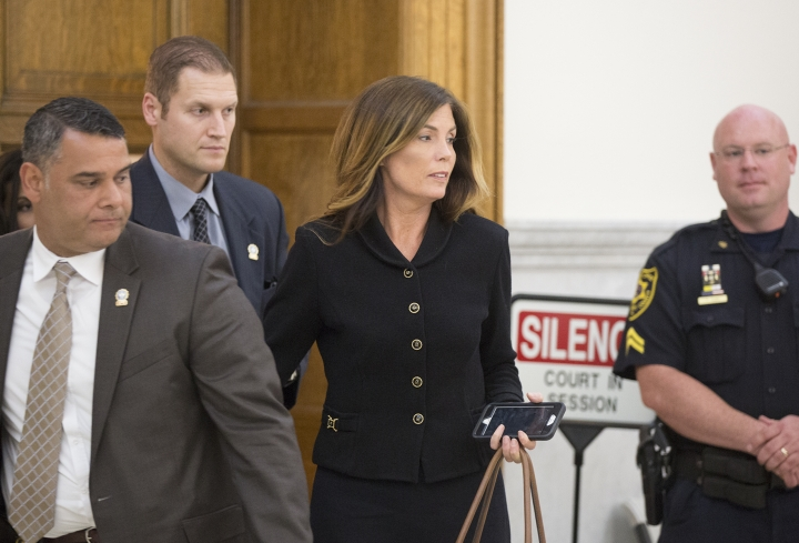 Pennsylvania Attorney General Kathleen Kane, escorted by members of her security team, prepares to leave the Montgomery County Courthouse and await a verdict, in Norristown, Pa., Monday, Aug. 15, 2016. Kane was convicted Monday of all nine charges against her in a perjury and obstruction case related to a grand jury leak but insisted she's innocent and vowed to appeal. Kane, the first Democrat and first woman elected to the office, showed little emotion as jurors announced their verdict Monday. (Ed Hille/The Philadelphia Inquirer via AP, Pool)