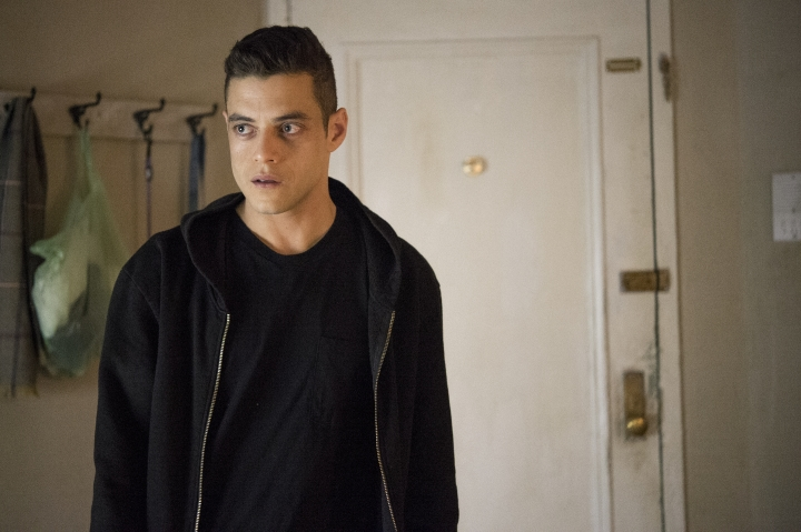 "This image released by USA Network shows Rami Malek as Elliot Alderson in a scene from ""Mr. Robot."" A fake messaging app inspired by the USA Network hacker drama was released Tuesday for mobile devices. ""Mr. Robot:1.51exfiltratiOn"" casts players as a stranger who finds a mysterious smartphone and begins communicating with the show's characters through an app published by the fictional E-Corp. (David Giesbrecht/USA Network via AP)"