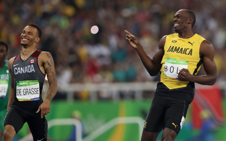 Jamaica's Usain Bolt, right, and Canada's Andre De Grasse compete in a men's 200-meter semifinal during the athletics competitions of the 2016 Summer Olympics at the Olympic stadium in Rio de Janeiro, Brazil, Wednesday, Aug. 17, 2016 (AP Photo/Lee Jin-man)