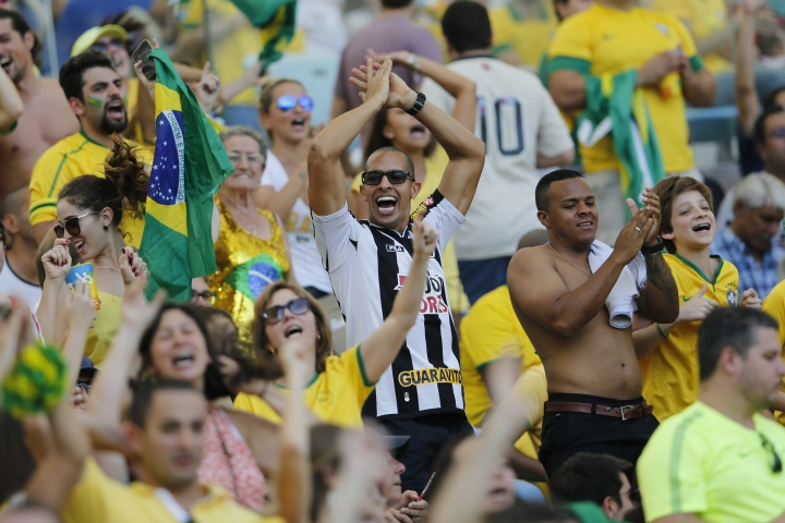 fans of Brazil cheer during a semi-final match of the men's Olympic football tournament between Brazil and Honduras at the Maracana stadium in Rio de Janeiro, Brazil, Wednesday Aug. 17, 2016. (AP Photo/Silvia Izquierdo)