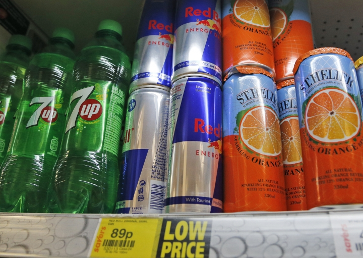 Drinks are on display at a supermarket in London, Thursday, Aug. 18, 2016. Britain has unveiled a plan to battle rising child obesity by urging food manufacturers to cut down on sugar and getting primary schools to make pupils do more exercise. But health campaigners have slammed the government for failing to restrict junk food advertising aimed at children. (AP Photo/Frank Augstein)