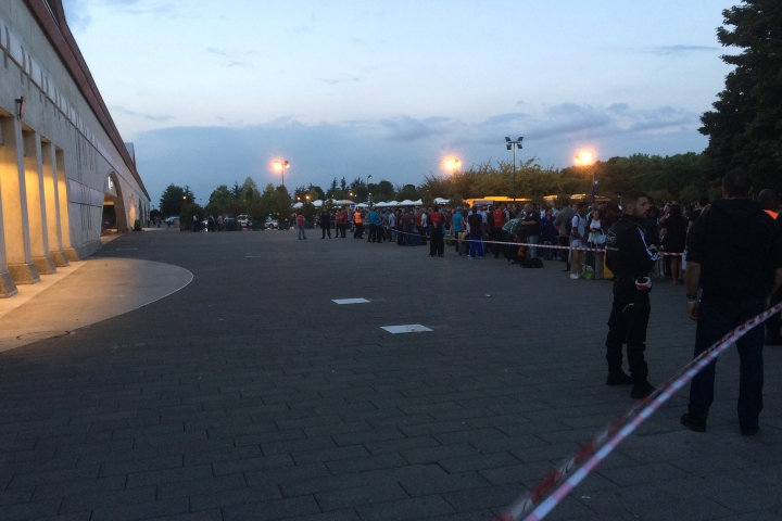 Police cordon off the area while passengers wait outside the Marne la Vallee train station, near to Disneyland east of Paris, Thursday, Aug. 18, 2016, after the station was evacuated following a warning about a suspicious package. Disneyland Paris said the park remained open to the public. Stations close to the site have been evacuated a few times in recent weeks in false alarms amid a summer of tensions after deadly extremist attacks. (AP Photo/Philippe Sotto)