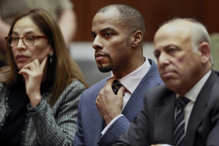 FILE - In this March 23, 2015, file photo, former NFL safety Darren Sharper, center, with his attorneys, Lisa Wayne, left, and Leonard Levine, right, appear in Los Angeles Superior Court. Sharper has been sentenced to 18 years in prison in a case where he was accused of drugging and raping as many as 16 women in four states. Judge Jane Triche Milazzo sentenced Sharper on Thursday, Aug. 18, 2016, in New Orleans. (AP Photo/Nick Ut, Pool, File)