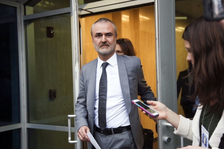 FILE - In this Friday, March 18, 2016, file photo, Gawker founder Nick Denton walks out of the courthouse in St. Petersburg, Fla. Gawker.com is going to shut down as its parent company is sold to Univision, a reporter for the 14-year-old site said Thursday, Aug. 18, 2016. (Eve Edelheit/The Tampa Bay Times via AP, File)