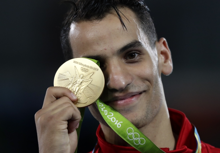 Ahmad Abughaush, of Jordan, shows of his gold medal in the men's 68-kg taekwondo competition at the 2016 Summer Olympics in Rio de Janeiro, Brazil, Thursday, Aug. 18, 2016. Abughaush won the gold. (AP Photo/Robert F. Bukaty)