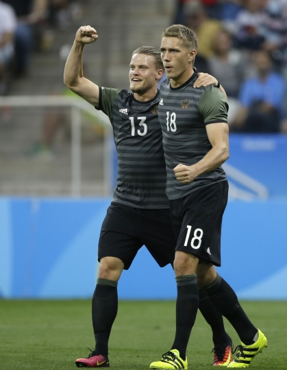 Germany's Nils Petersen, right, celebrates scoring his side's 2nd goal with his teammate Philipp Max during a semi-final match of the men's Olympic football tournament between Germany and Nigeria in Sao Paulo, Wednesday Aug. 17, 2016. Germany won the match 2-0 and qualified to the final against Brazil. (AP Photo/Nelson Antoine)
