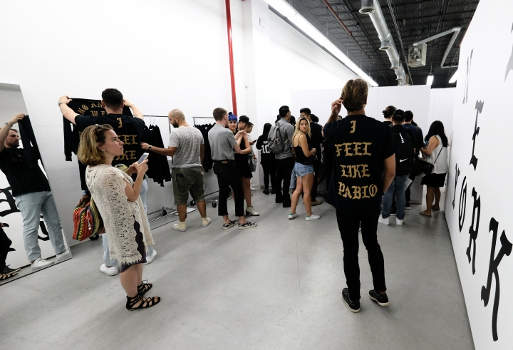 "Shoppers appear at Kanye West's ""Pablo"" pop-up shop in Lower Manhattan on Friday, Aug. 19, 2016, in New York. The rapper-turned-fashion mogul announced plans to open 21 stores worldwide just for this weekend to sell clothing based on his latest album, ""The Life of Pablo."" (Photo by Evan Agostini/Invision/AP)"
