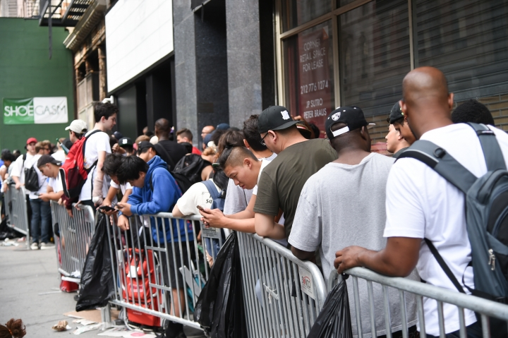 "Fans wait outside to get in to Kanye West's ""Pablo"" pop-up shop in Lower Manhattan on Friday, Aug. 19, 2016, in New York. The rapper-turned-fashion mogul announced plans to open 21 stores worldwide just for this weekend to sell clothing based on his latest album, ""The Life of Pablo."" (Photo by Evan Agostini/Invision/AP)"
