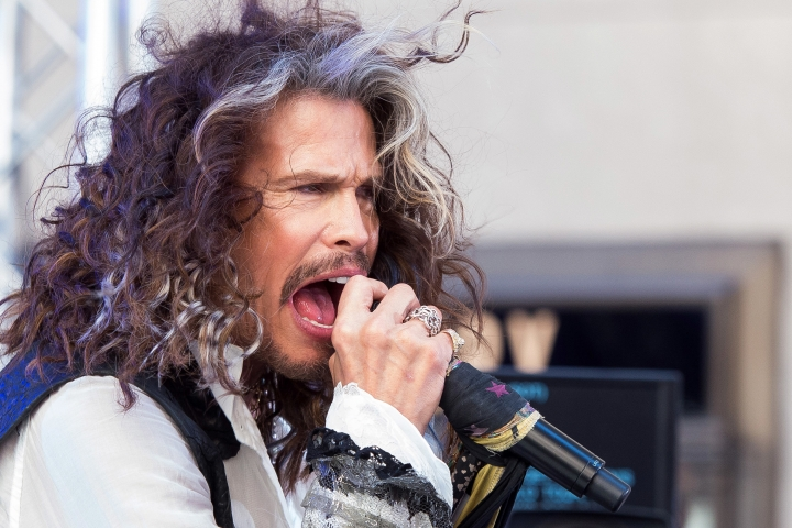 "FILE- In this June 24, 2016, file photo, Steven Tyler performs on NBC's ""Today"" show at Rockefeller Center in New York. Tyler posted a photo of himself Thursday, Aug. 18, on social media making the same gesture with his fingers that he did in the opening video for the Rock 'n' Roller Coaster Starring Aerosmith at Disney's Hollywood Studios in Orlando, Fla. Several videos and images posted on social media this week by visitors to the theme park show Tyler's fingers have been changed. (Photo by Charles Sykes/Invision/AP, File)"