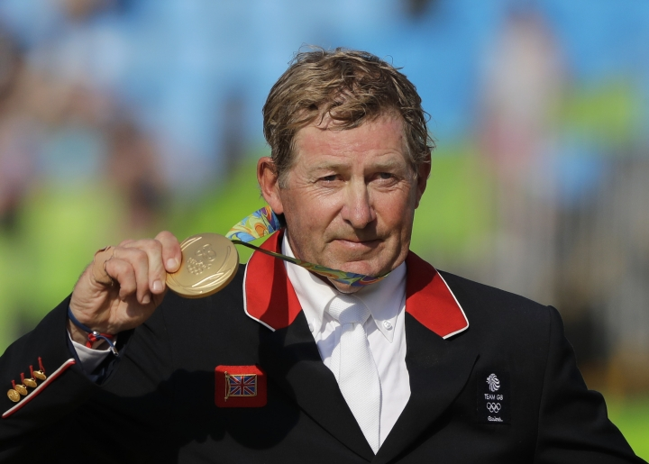 Gold medalist Nick Skelton, of Britain, poses for photos during a medal ceremony for the equestrian individual jumping competition at the 2016 Summer Olympics in Rio de Janeiro, Brazil, Friday, Aug. 19, 2016. (AP Photo/Jae C. Hong)