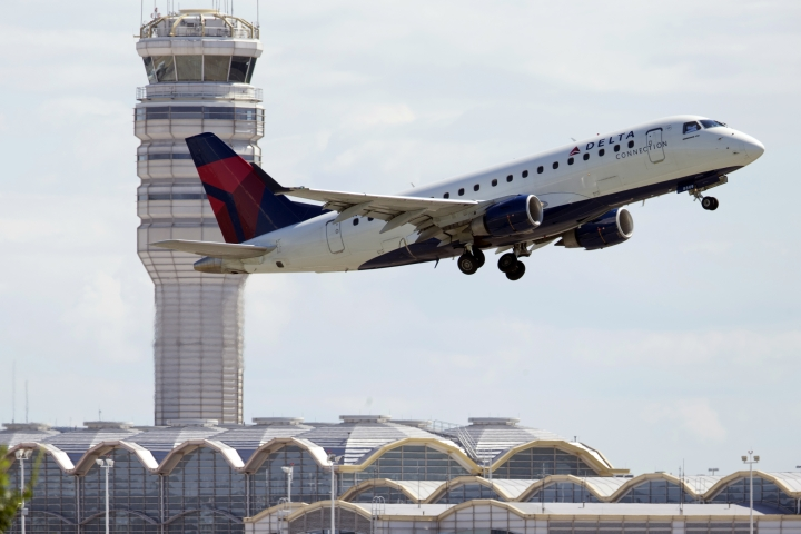 FILE - In this July 28, 2014 file photo, a Delta Air Lines jet takes off from Ronald Reagan Washington National Airport in Arlington, Va. Most restrictions on flights between the U.S. and Mexico will lift on Sunday, Aug. 21, 2016, a change expected to bring more options and possibly lower prices for travelers. American, Delta and Southwest have already announced that they will offer new flights across the border later this year. United is watching the demand for flights and will respond accordingly, a spokesman said. (AP Photo/Manuel Balce Ceneta, File)