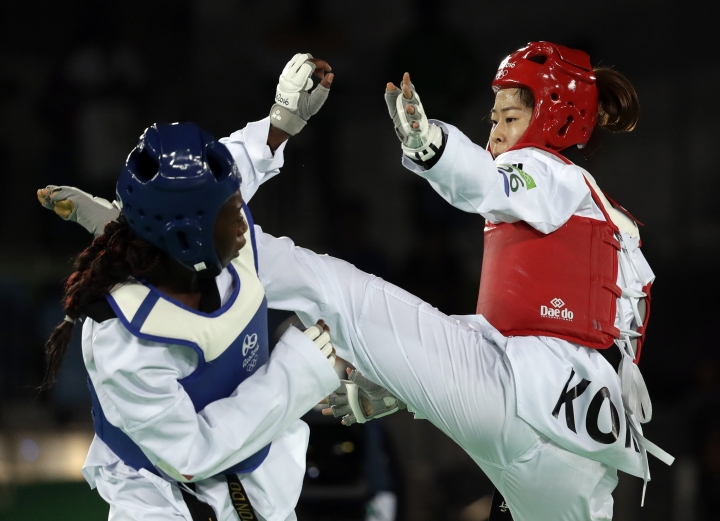 Haby Niare of France, left, and Oh Hyeri of South Korea compete in a women's Taekwondo 67-kg final at the 2016 Summer Olympics in Rio de Janeiro, Brazil, Friday, Aug. 19, 2016. (AP Photo/Andrew Medichini)