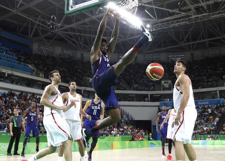 United States' DeAndre Jordan, center, scores against Spain during a men's semifinal round basketball game at the 2016 Summer Olympics in Rio de Janeiro, Brazil, Friday, Aug. 19, 2016. (AP Photo/Eric Gay)