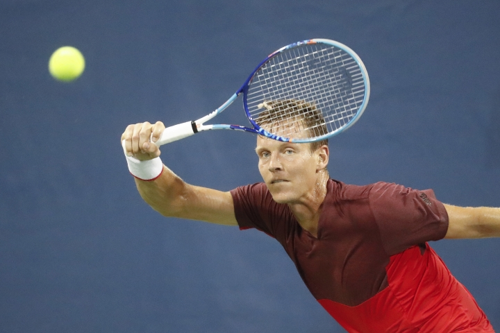 Tomas Berdych, of the Czech Republic, returns to Marcel Granollers, of Spain, during the Western & Southern Open tennis tournament, Wednesday, Aug. 17, 2016, in Mason, Ohio. (AP Photo/John Minchillo)