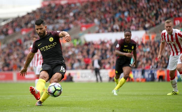 Manchester City's Sergio Aguero, foreground, scores his side's first goal of the match from the penalty spot, during the English Premier League soccer match between Stoke City and Manchester City, at The Bet365 Stadium, in Stoke-on-Trent, England, Saturday, Aug. 20, 2016. (Nick Potts/PA via AP)
