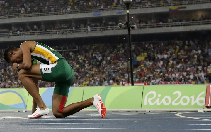 FILE - In this Aug. 14, 2016 file photo, South Africa's Wayde Van Niekerk pauses after winning the gold in the men's 400-meter final during the athletics competitions of the 2016 Summer Olympics at the Olympic stadium in Rio de Janeiro, Brazil. (AP Photo/Matt Dunham, File)