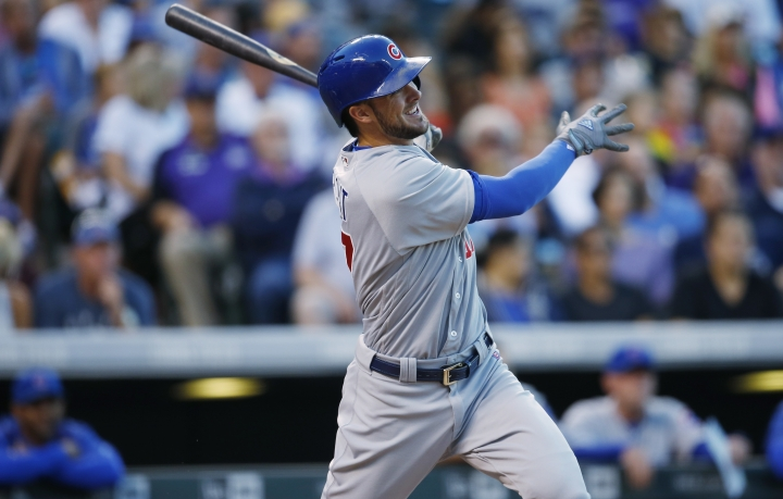 Chicago Cubs' Kris Bryant follows the flight of his three-run home run off Colorado Rockies starting pitcher Jeff Hoffman in the fifth inning of a baseball game Saturday, Aug. 20, 2016, in Denver. The Cubs won 9-2. (AP Photo/David Zalubowski)