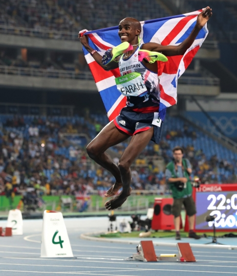 Britain's Mo farah celebrates winning the men's 5000-meter during athletics competitions at the Summer Olympics inside Olympic stadium in Rio de Janeiro, Brazil, Saturday, Aug. 20, 2016. (AP Photo/Lee Jin-man)