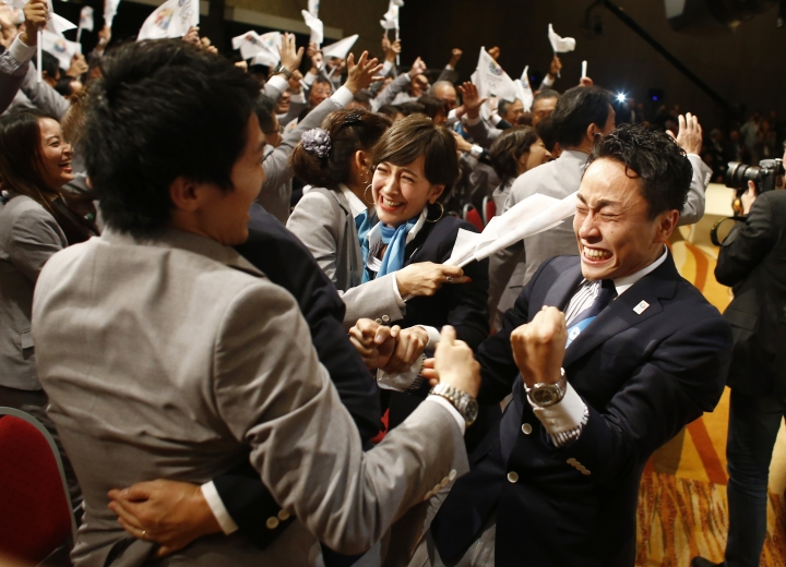 FILE - In this Sept. 7, 2013 file photo, members of the Tokyo 2020 delegation celebrate after Tokyo was awarded the 2020 Olympic Games during the 125th IOC session in Buenos Aires, Argentina. The next three Olympics are headed for relatively calmer ports of call in South Korea, Japan and China following the organizational drama surrounding the 2014 Winter Olympics in Russia and the just completed Summer Games in Brazil, but challenges remain, especially when it comes to finances and generating enthusiasm among home audiences. (AP Photo/Victor R. Caivano, File)