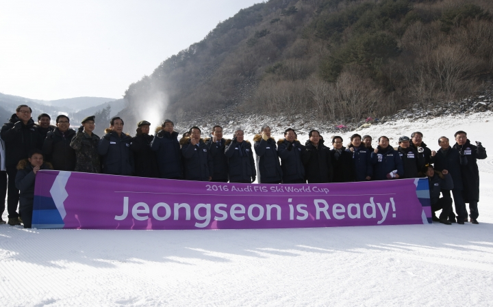 FILE - In this Jan. 22, 2016 file photo, South Korean members of the Pyeongchang 2018 Winter Olympics Organizing Committee and government officers cheer with a banner for the upcoming official Test Event of the Pyeongchang 2018 Winter Olympics at the Jeongseon Alpine Centre in Jeongseon, South Korea. The next three Olympics are headed for relatively calmer ports of call in South Korea, Japan and China following the organizational drama surrounding the 2014 Winter Olympics in Russia and the just completed Summer Games in Brazil, but challenges remain, especially when it comes to finances and generating enthusiasm among home audiences. (AP Photo/Lee Jin-man, File)