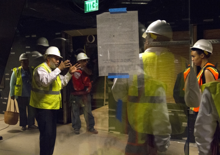 In this photo taken July 18, 2016, Museum Director Lonnie Bunch, left, talks during a media tour of the Smithsonian's National Museum of African American History and Culture in Washington. The museum's grand opening will be on Sept. 24. (AP Photo/Paul Holston)