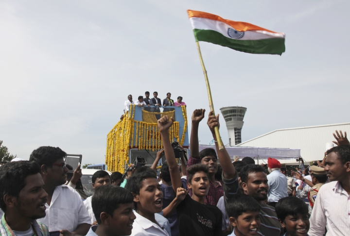 Pusarla Sindhu, one of the only two Indians to win medals at the just concluded Rio Olympics, is brought home in a procession along with her coach, Pullela Gopichand, upon their arrival in Hyderabad, India, Monday, Aug. 22, 2016. Sindhu won silver in women's singles badminton. (AP Photo/ Mahesh Kumar A)