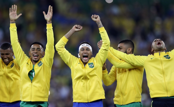 Brazil's Neymar, center, celebrates with teammates during the medal ceremony after the final match of the men's Olympic football tournament between Brazil and Germany at the Maracana stadium in Rio de Janeiro, Brazil, Saturday, Aug. 20, 2016. Brazil won the gold medal on a penalty shootout. (AP Photo/Andre Penner)