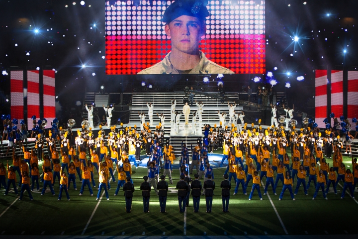 "This image released by Sony Pictures shows Joe Alwyn, portraying Billy Lynn, on a screen in a scene from the film, ""Billy Lynn's Long Halftime Walk."" The film, by Ang Lee, will premiere at the New York Film Festival on Oct. 14. (Mary Cybulski/Sony-TriStar Pictures via AP)"
