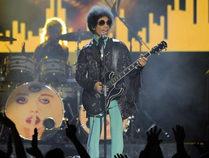 FILE - In this May 19, 2013 file photo, Prince performs at the Billboard Music Awards at the MGM Grand Garden Arena in Las Vegas. Several pills taken from Prince's estate in Paisley Park after his death were counterfeit drugs that actually contained fentanyl,a synthetic opioid 50 times more powerful than heroin, an official close to the investigation said Sunday, Aug. 21, 2016. (Photo by Chris Pizzello/Invision/AP, File)