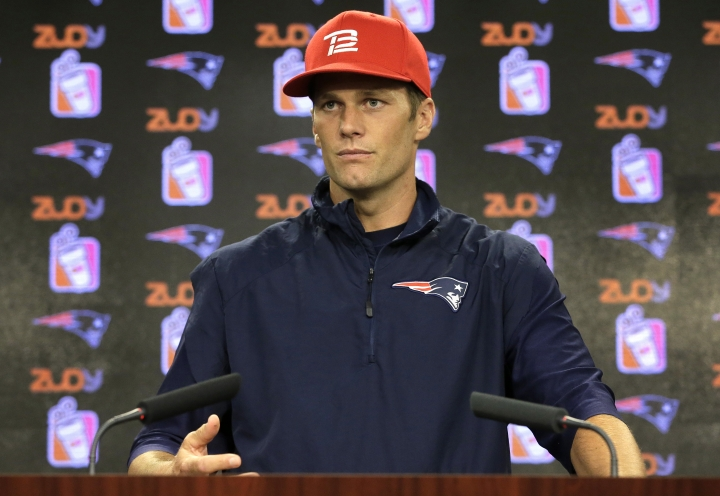 "New England Patriots quarterback Tom Brady takes questions from members of the media during a news conference before a scheduled NFL football training camp practice Tuesday, Aug. 23, 2016, in Foxborough, Mass. Brady says he's ready to play after a ""silly accident"" cut his right thumb with a pair of scissors before the Patriots preseason game against the Bears last week. (AP Photo/Steven Senne)"