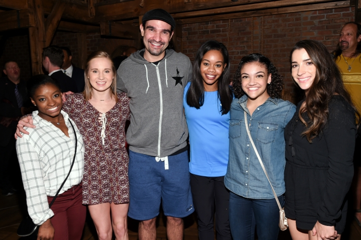 "Members of the ""Final Five"" Rio Olympics gold medal-winning U.S. Gymnastics team, from left, Simone Biles, Madison Kocian, Gabby Douglas, Laurie Hernandez and Aly Raisman pose with ""Hamilton"" star Javier Muñoz after attending the performance at the Richard Rogers Theatre on Tuesday, Aug. 23, 2016, in New York. (Photo by Evan Agostini/Invision/AP)"