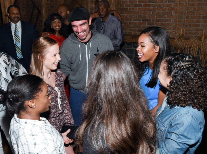 """Members of the """"Final Five"""" Rio Olympics gold medal-winning U.S. Gymnastics team, clockwise from left, Simone Biles, Madison Kocian, Gabby Douglas, Laurie Hernandez and Aly Raisman chat with """"Hamilton"""" star Javier Muñoz after attending the performance at the Richard Rogers Theatre on Tuesday, Aug. 23, 2016, in New York. (Photo by Evan Agostini/Invision/AP)"""