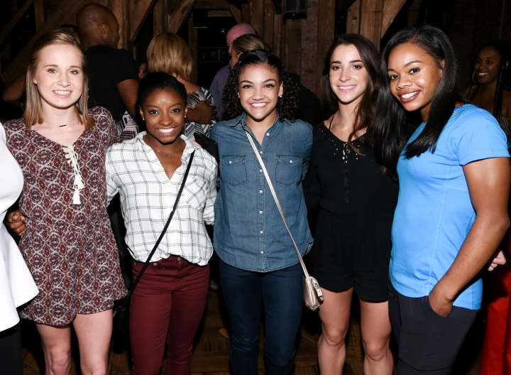 "Members of the ""Final Five"" Rio Olympics gold medal-winning U.S. Gymnastics team, from left, Madison Kocian, Simone Biles, Laurie Hernandez, Aly Raisman and Gabby Douglas pose together backstage after attending performance of ""Hamilton"" at the Richard Rogers Theatre on Tuesday, Aug. 23, 2016, in New York. (Photo by Evan Agostini/Invision/AP)"