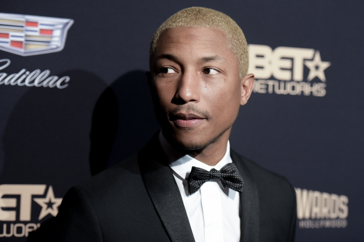 "FILE- In this Feb. 21, 2016, file photo, Pharrell Williams attends the 2016 ABFF Awards: A Celebration of Hollywood held at the Beverly Hilton Hotel in Beverly Hills, Calif. Clive Davis is honoring the ""Happy"" and ""Freedom"" singer-songwriter with his Legend in Songwriting Award. Pharrell is scheduled to receive the honor Sept. 15 from the veteran music executive at the 12th annual Songs of Hope event. (Photo by Richard Shotwell/Invision/AP, File)"