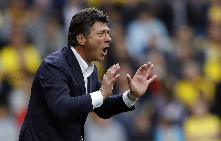 Watford's team manager Walter Mazzarri getures, during the English Premier League soccer match between Watford and Chelsea at Vicarage Road stadium in London, Saturday, Aug. 20, 2016. (AP Photo/Frank Augstein)