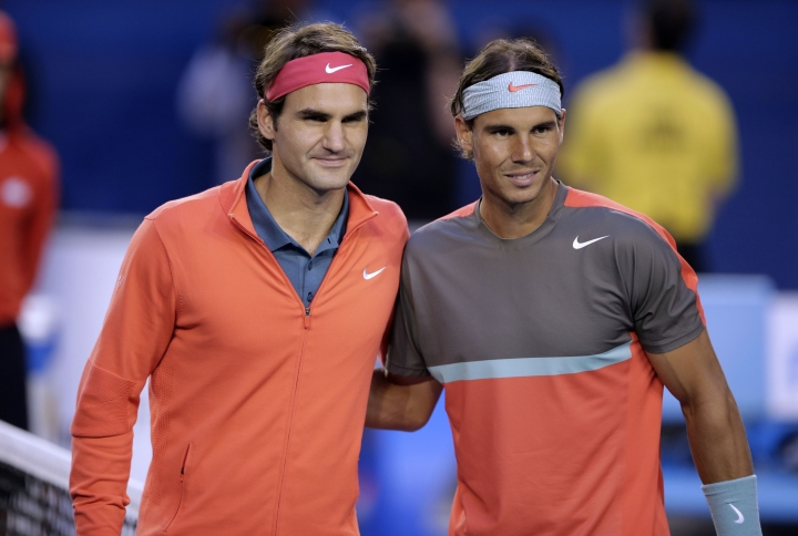 FILE - In this Jan. 24, 2014, file photo, Rafael Nadal of Spain, right, and Roger Federer of Switzerland pose at the net before their semifinal at the Australian Open tennis championship in Melbourne, Australia. Federer and Nadal say they plan to play doubles together when the Laver Cup debuts next year. (AP Photo/Rick Rycroft, File)