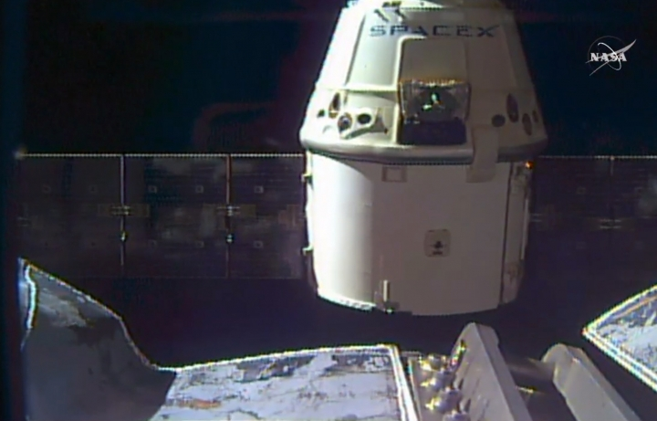 In this frame grab taken from NASA Television, a SpaceX Dragon capsule separates from a robotic arm of the International Space Station en route back to Earth with a load of science experiments and gear from the space station, Friday, Aug. 26, 2016. (NASA via AP)