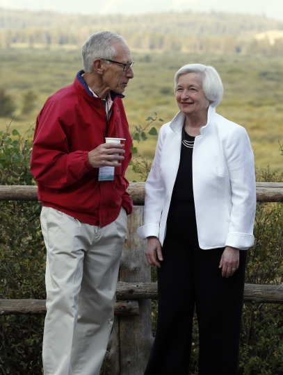 Federal Reserve Chair Janet Yellen, right, talks with Stanley Fischer, vice chairman of the Board of Governors of the Federal Reserve System, before her speech to the annual invitation-only conference of central bankers from around the world, Friday, Aug 26, 2016, at Jackson Lake Lodge in Grand Teton National Park, north of Jackson Hole, Wyo. (AP Photo/Brennan Linsley)
