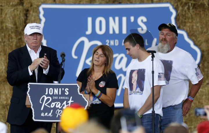 Republican presidential candidate Donald Trump shares the stage with the family of Sarah Root at Joni's Roast and Ride at the Iowa State Fairgrounds, in Des Moines, Iowa, Saturday, Aug. 27, 2016. Second left is Sarah's mother, Michelle Root, brother Scott Root, and father Scott Bernhardt. Sarah Root was killed earlier this year after her car was hit by another. The driver, who was drunk, was a reportedly Honduran immigrant living in the country illegally. (AP Photo/Gerald Herbert)