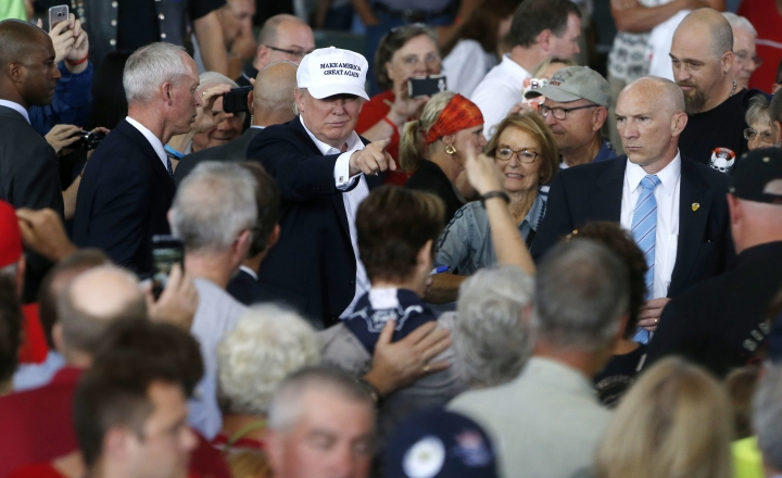 Republican presidential candidate Donald Trump greets the crowd after speaking at Joni's Roast and Ride at the Iowa State Fairgrounds, in Des Moines, Iowa, Saturday, Aug. 27, 2016. (AP Photo/Gerald Herbert)