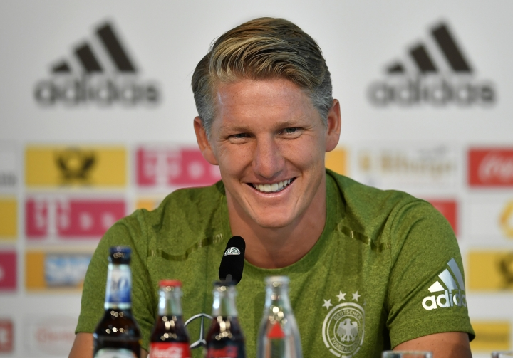 Germany's captain Bastian Schweinsteiger talks to the media at a press conference in Duesseldorf, Germany, prior the friendly soccer match against Finland, Tuesday, Aug. 30, 2016. Schweinsteiger will play his last match for the national team on Wednesday in Moenchengladbach, Germany. (AP Photo/Martin Meissner)