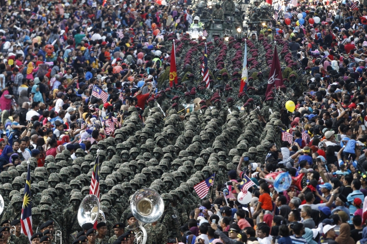 Malaysian Army personnel marches during the 59th National Day celebrations at the Independence Square in Kuala Lumpur, Malaysia on Wednesday, Aug. 31, 2016. Malaysia gained its independence on Aug. 31, 1957. (AP Photo/Joshua Paul)