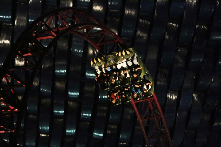 Daredevils ride the Predator roller coaster at the IMG Worlds of Adventure amusement park in Dubai, United Arab Emirates, on Wednesday, Aug. 31, 2016. in Dubai, United Arab Emirates, on Wednesday, Aug. 31, 2016. The IMG Worlds of Adventure indoor theme park opened Wednesday in Dubai, hoping to draw thrill seekers to its air-conditioned confines. (AP Photo/Jon Gambrell)