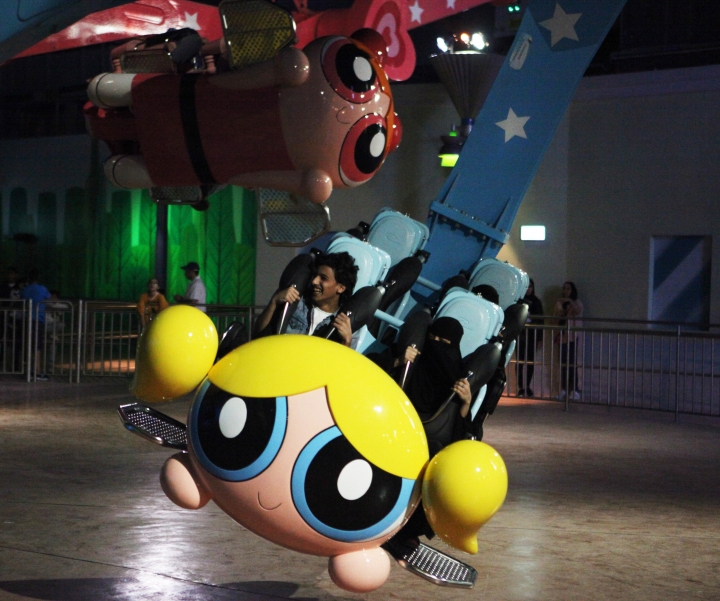 People shout as they experience the Powerpuff Girls - Mojo Jojo's Robot Rampage ride at the IMG Worlds of Adventure amusement park in Dubai, United Arab Emirates, on Wednesday, Aug. 31, 2016. The IMG Worlds of Adventure indoor theme park opened Wednesday in Dubai, hoping to draw thrill seekers to its air-conditioned confines. (AP Photo/Jon Gambrell)