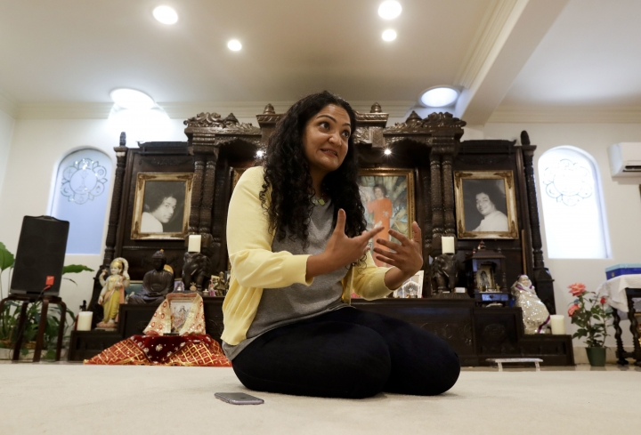 In this Thursday, Aug. 4, 2016 photo, Dr. Krupali Tejura talks about the proposal for a Hindu cultural center at her parents home, in Corona, Calif. A Southern California city has rejected plans for a proposed Hindu cultural center partly because officials say the large, domed building doesn't fit in with its Old West-style motif. Tejura, a radiation oncologist who grew up in nearby Corona and works at an area hospital, got involved in the debate because she was offended by those who argued the center didn't fit. (AP Photo/Chris Carlson)