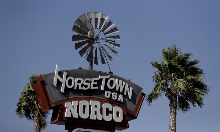 In this Thursday, Aug. 4, 2016 photo, the Norco town sign is seen in Norco, Calif. The Southern California city has rejected plans for a proposed Hindu cultural center partly because officials say the large, domed building doesn't fit in with its Old West-style motif. The decision last month by the city of Norco has riled some Indian-Americans who say the move was discriminatory. (AP Photo/Chris Carlson)
