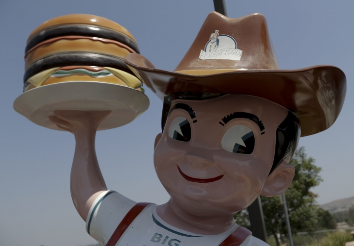 In this Thursday, Aug. 25, 2016 photo, the Bob's Big Boy statue sports a cowboy hat in Norco, Calif. The city of Norco has rejected plans for a proposed Hindu cultural center partly because officials say the large, domed building doesn't fit in with its Old West-style motif. The decision last month by the city of Norco has riled some Indian-Americans who say the move was discriminatory. (AP Photo/Chris Carlson)